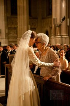 So sweet! This bride shared a special moment with her grandmother during the ceremony to honor their close relationship.
