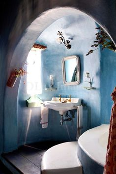blue clay and concrete bathroom