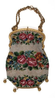This mid nineteenth century beaded bag has rings on the handle where it would have been worn hanging from the finger, against the dress of the owner.