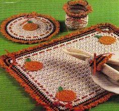 Free Crochet Pumpkin Kitchen Set Pattern.  Hmm, cross stitch a fall pattern onto instead of pumpkin 'appliqués' in corners?