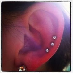 Triple Helix Body Piercing done at In Living Color Tattoo in Plattsburgh, NY