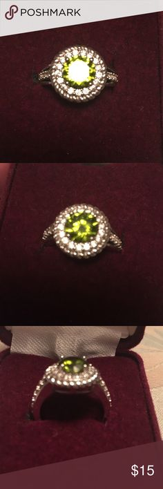 Beautiful peridot and cubic zirconia silver ring Beautiful  fashion ring with peridot stone surrounded by  cubic zirconia. Size 6. Silver band Jewelry Rings