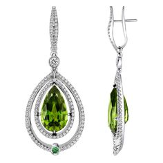Peridot Gold Dangle Earrings | From a unique collection of vintage dangle earrings at https://www.1stdibs.com/jewelry/earrings/dangle-earrings/