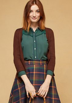 <p>Whether you're feeling a little bit country, a pinch rock 'n' roll, or anywhere in between, you'll have a blast styling this green button up! A vintage-inspired find from our ModCloth namesake label, this chiffon blouse is loaded with versatile personality, from its sheer contrast shoulders and navy piping to its pearly buttons.</p>