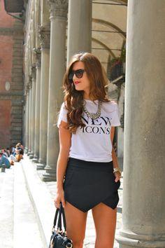 Graphic tee and black leather skort, black sandals, chunky necklace