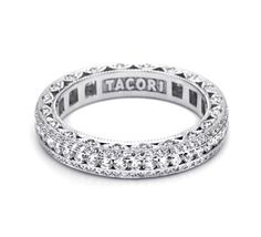 Stunning design. This elegant platinum and diamond band is pictured with pave-set strings of diamonds and channel set round diamonds. Diamond crescent silhouette details add beauty from every angle.