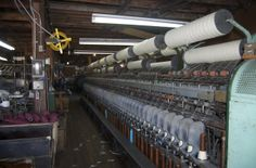 Wool Spinning Mills | ... on the spinning machine here. The yarn is being spun onto the cones