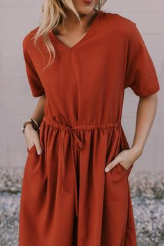 Add festive color to your wardrobe with this modest pocket dress! This modest pocket dress features v-neck, and is made with thin, textured fabric. Simple Outfits, Simple Dresses, Nice Dresses, Cute Outfits, Modest Dresses, Casual Dresses, Rust Color Dress, Cowgirl Tuff, Cowgirl Style