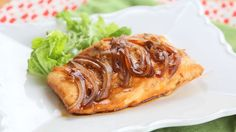 Delicious salmon with only four ingredients: salmon, onions, garlic, and teriyaki.