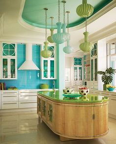 Thinking outside of the box!  LOVE these colors...and the counter top and the blue back splash and the cabinets and especially the pendants....