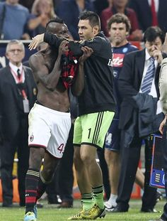 #Mario Balotelli is restrained by teammate #Marco Amelia after receiving a red card at the end of the Serie A soccer match between AC Milan and Napoli.  Read here - http://tnie.in/18UyIvI