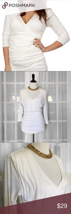 H&M White Faux Wrap 3/4 Sleeve Top Comfortably fitted White top by H&M features half wrapped bust, gathered fabric on sides for a flattering look, long tunic length. Gorgeously matched with almost any work or play outfits! Fabric is like New and stain/pull free. H&M Tops Tees - Long Sleeve