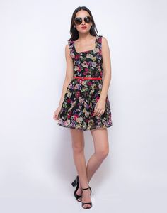 Garden of Roses Skater Dress : Absolutely adorable black georgette skater dress featuring a multicolor rose print all over and a side zip closure. The skinny red belt ensures a perfect fit and flare effect.  Work It - Nail summer day chic wearing yours with funky sunglasses and flats.