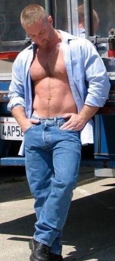 Relaxing with open shirt in Levi's with eye-catching bulge.