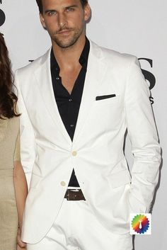 A White Suit with a Contrasting Black Shirt and Pocket Square
