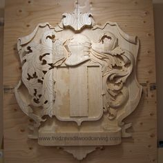 Carved family crest, basswood