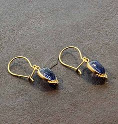 Bask+Kyanite+and+Diamond+Earrings+-+Enmeshed+in+the+Bali+culture,+Steven+achieves+his+diverse+collection+by+engaging+the+skills+of+local+smiths+using+metal,+fire,+and+stones++to+create+his+beautiful+and+expansive+line.