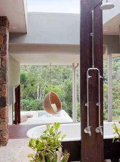 Australian Straw Bale House – Byron Hinterland. Eco friendly and sustainable. House with solar panels, compels table toilet, water systems. Great outdoor Shower, pool and hanging pod / chair.