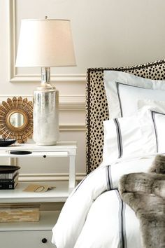 Classy and chic bedroom with leopard headboard and hotel bed linens.