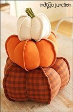 "Indygo Junction's Pumpkin Trio will dress up your home for fall with our set of three pumpkins. Two styles included - dimensional exterior seams or traditional seaming. Use real dried stems or create your own leaf and stem details from Crossroads Denim. Pumpkins are large (10.5"" D), medium (8.5"" D) or small (6.5"" D). Sizes are approximate. $9.99"