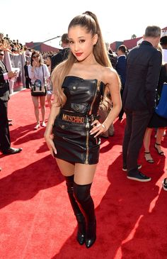 Ariana Grande at the 2014 MTV VMAs In case it wasn't clear by her belt, the singer wore a black leather top and skirt by Moschino along with Tom Ford boots and Borgioni black diamond stud earrings.