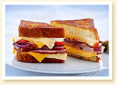 The Dagwood Grilled Cheese Featuring American Cheese, Sliced Swiss, and Ham on Fresh White Bread.