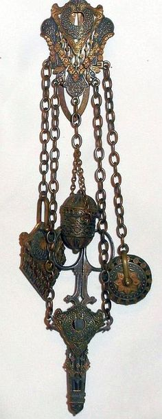 ANTIQUE UNUSUAL ORNATE SEWING CHATELAINE WITH 5 IMPLEMENTS.