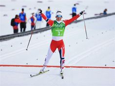 Marit Bjoergen of Norway crosses the line to win the gold medal with team mate Ingvild Flugstad Oestberg of Norway (not pictured) in the Women's Team Sprint Classic Final during day 13 of the 2014 Sochi Winter Olympics at Laura Cross-country Ski & Biathlon Center