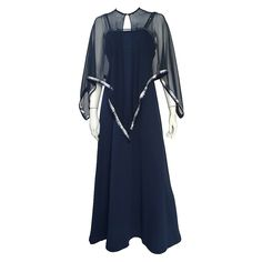 Estevez 70s navy jersey gown & capelet trimmed in sequin size large.   From a collection of rare vintage evening dresses at https://www.1stdibs.com/fashion/clothing/evening-dresses/ @1stdibscom #vintage #luxury #Estevez #resale #consignment #shopping #fashion