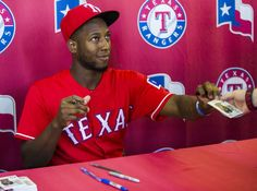 Texas Rangers infielder Jurickson Profar (19) signs autographs in the outfield concourse before their game against the Houston Astros on Wednesday, June 8, 2016 at Globe Life Park in Arlington, Texas. (Ashley Landis/The Dallas Morning News)