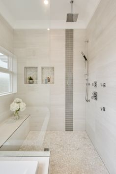 Custom shower in Vancouver using full Schluter curb, base, seat, niches, and waterproofing.
