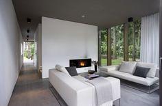 Simple clean integration of flush minimalist fireplace into wall | ahlbrecht felix scheidt kasprusch Architects | Berlin, Germany