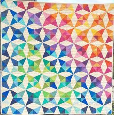 Today I get to share my version of the Fat Quarter Shop's Summer Breeze Quilt Pattern. I named my quilt Rainbow Breeze. It's been hard working on this quilt in secret for much of the summer. This cl