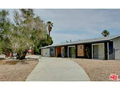 Sold  Homes by Tracy Merrigan 3034 N Cerritos Rd, Palm Springs #PalmSprings Circular driveway and large front yard with olive tree  tracymerrigan.com