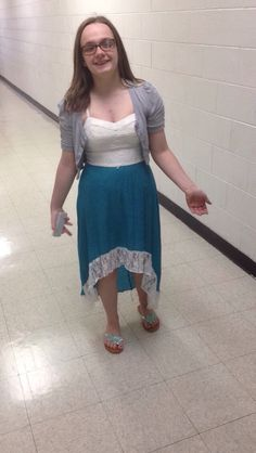 Outfit of the day is a white and blue high low dress, with a grey cardigan and silver sandals.