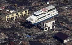 This sightseeing boat, Hama Yuri, was pulled 1300 feet from the coast and somehow balanced itself on a two story house during the tsunami in Japan.