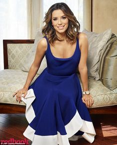 Chic and classy: For the inside spread, the actress donned a royal blue dress with a scoop...