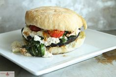 Grilled Potobello Mushroom Burger with Roasted Ricotta, Basil and Cherry Tomatoes @Heather Creswell Christo
