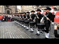 The Top Secret Drum Corps of Basel, Switzerland, with a surprise performance in West Parliament Square, Edinburgh, Scotland, 2015