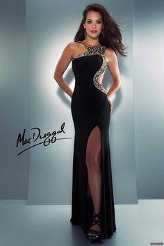 Mac Duggal Style 81818A - Featured in Seventeen / Teen Prom Magazines!  Slinky black jersey dress with side cut out and high leg slit.  Neckline and cut out are encrusted with AB stones.  Red carpet ready in this stunning gown.