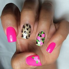 Rose, pink, and leopard print nail art.