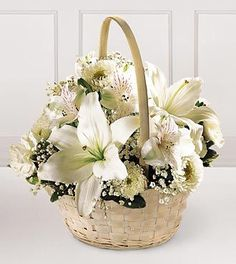 This elegant and sophisticated bouquet is comprised of all white flowers. Lilies, roses, larkspur, and traditional gladiolus are designed in a stylish pedestal vase. Appropriate for the funeral home...