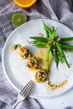 A simple recipe for Seared Scallops with Orange-Lime Dressing served with green beans - a light and healthy meal that can be made in 20 minutes!