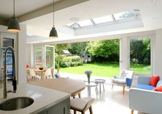 Orangery Kitchen Extension provides dining and living areas in South West London Open Plan Kitchen Living Room, Kitchen Dining Living, Kitchen Family Rooms, Dining Room, Bungalow Extensions, House Extensions, Kitchen Extensions, Conservatory Kitchen, Conservatory Extension