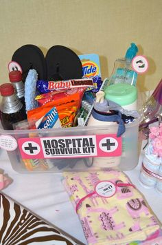 Hospital Survival Kit: Baby Shower Gift!  I like the idea of this.  I would put in coconut water, Clif bars, hair ties and chapstick as essentials.  The candy is a great offering to hospital staff!