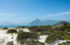 "Situated on one of the largest stands in Klein Slangkop Estate, this world-class landmark home overlooks the bay where Kommetjie and Noordhoek come together, and the whales frolic and play. Timeless in design, with the finest of imported materials and current technology, this is living as close to"" Paradise"" as possible"