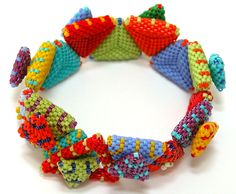 Nita E Kaufman - finally finished! Closes with big open triangle twisting over small one. So colorful, fun for summer! Baubles And Beads, Beaded Ornaments, Beads And Wire, Peyote Patterns, Bracelet Patterns, Beading Patterns, Beads Jewelry, Seed Bead Bracelets, Jewellery