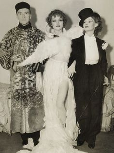 """Bjork's swan dress was but a rip-off of Marlene's swan dress. Clifton Webb, Marlene Dietrich, and Elizabeth Allan at a Hollywood theme party held by Basil Rathbone and wife Ouida Bergere in 1935. The theme was """"The Person You Most Admire."""" Dietrich chose Leda of the famous fable, while her escort for the night, Elizabeth Allen, went as Dietrich."""