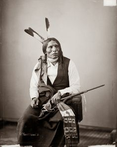 Yankton Sioux, known as Grizzly Bears Nose pictured with pipe, wampum and a feathered headdress taken in 1872
