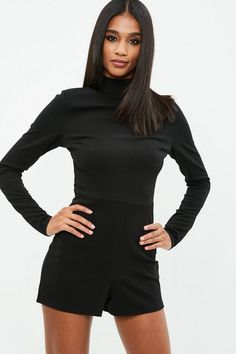 Black jersey romper with a high neck, long sleeves and zip back fastening.